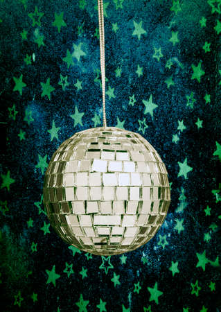 retro disco ball with stars and night sky blue background Stock Photo
