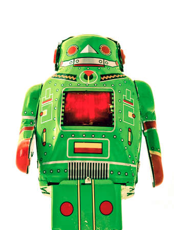 retro green robot toy looming above you