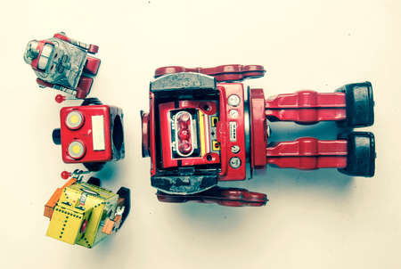 concept technical support;  woth a team of vintage robots fixing the big robots  head