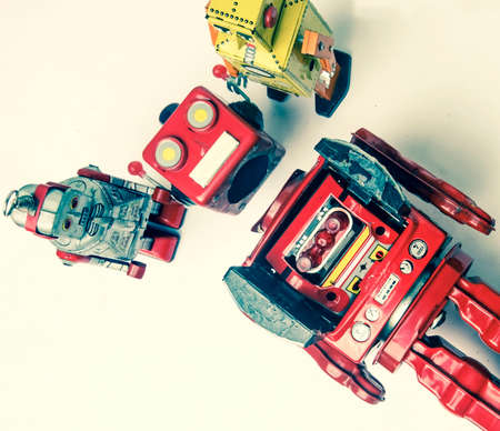 concept technical support;  woth a team of vintage robots fixing the big robots  head Stock fotó - 104908225