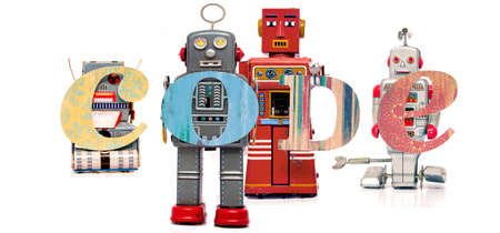 retro tin robot toys hold up the word   CODE isolated on white Stock fotó
