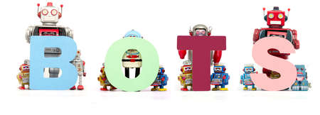 retro tin robot toys hold up the word  BOTS isolated on white Stock fotó