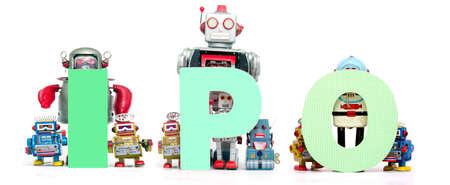 retro tin robot toys hold up the acronym  IPO isolated on white Stock fotó