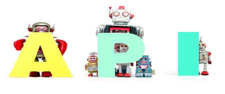 retro tin robot toys hold up the acronym API isolated on white Stock fotó