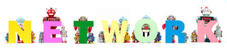 retro tin robot toys hold up the word  NETWORK solated on white banner Stock fotó