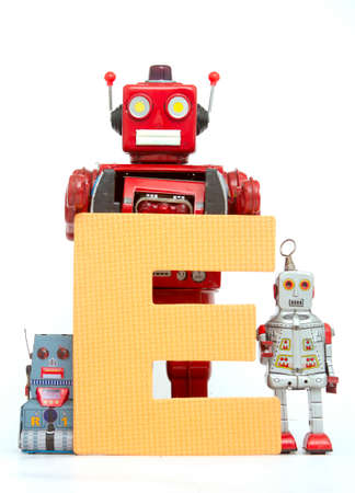 capital letter E held by vintage robot toys