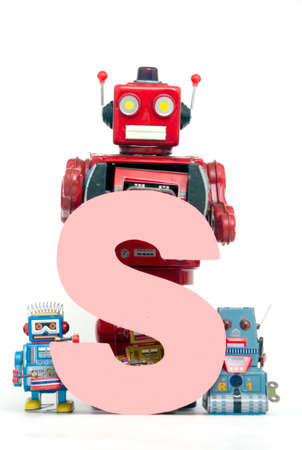 capital letter S held by vintage robot toys