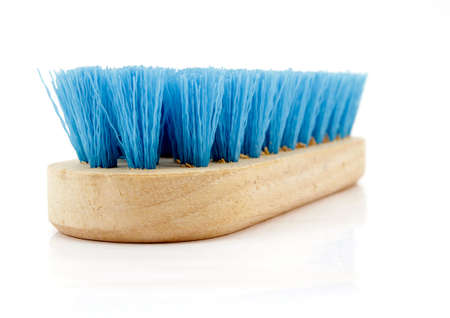 a wooden cleaning brush on white