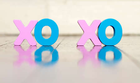 XO XO wooden letters on a old wooden floor with reflection soft color