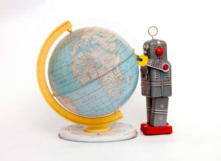 retro grey  robot sdudys the world isolated on white