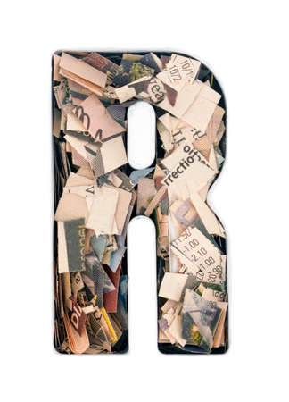 financial news newspaper cut up into confetti to make the captal letter,R