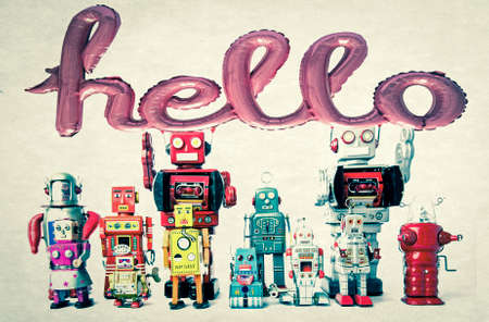 team of retro robots an a baloon hello toned image