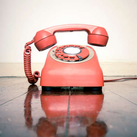 retro phone ringing on a old wooden floor with reflection Stock Photo