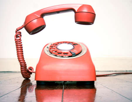 retro phone ringing on a old wooden floor with reflection Banque d'images