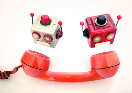 two robot heads and a old phone Stock fotó
