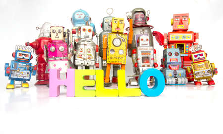 Big Family of robots with thw words HELLO with wooden letters