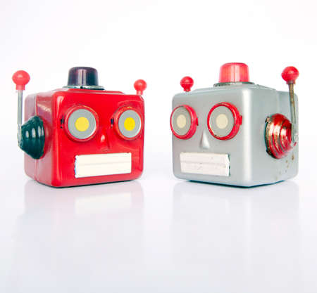 two retro robot heads chatiing isolated on white Stock fotó - 114862389