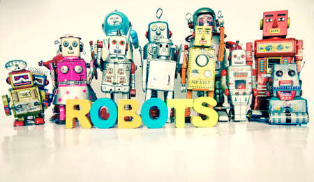 Big Family of robots with thw words ROBOTS with wooden letters