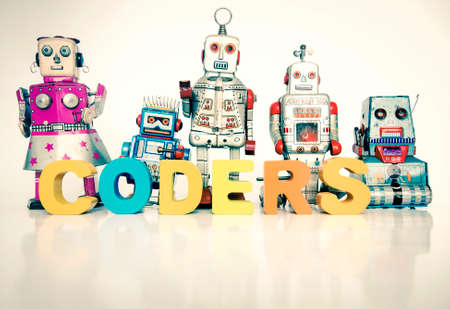 The word CODERS  with retro robot toys on white Stock fotó