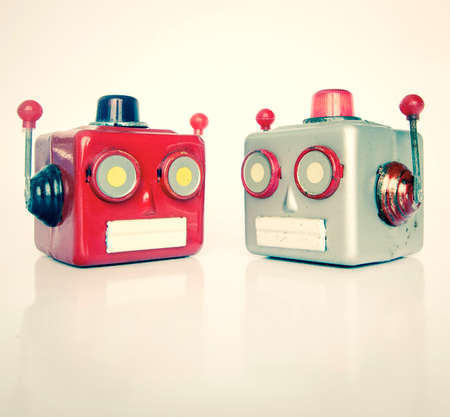 two retro robot heads chatiing isolated on white Stock fotó - 114862404