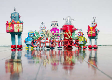 retro robots  with gifts on a old wooden floor  with reflection