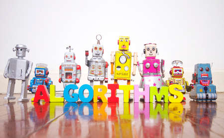 a line of retro robots on a wooden floor with the word ALGORITHMS  bright color Imagens