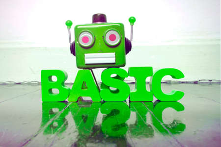 robot head and the word BASIC on a old wooden floor