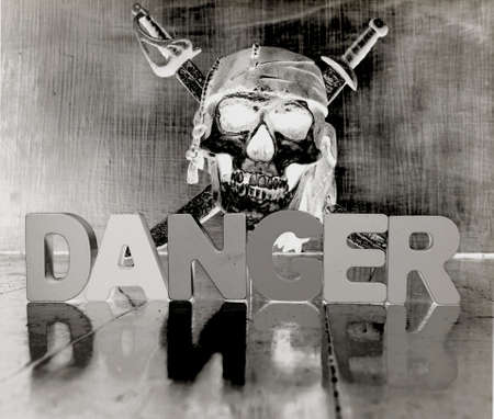 DANGER wothwooden letters and skull in solarized monochrome