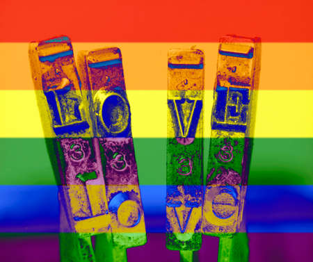 the word love with old typewriter hammers macro  rainbow colors abstract