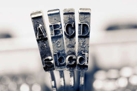 ABCD with old typewriter hammers in monochrome Imagens