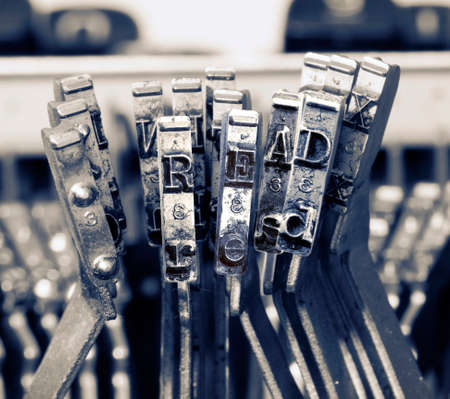 the word READ with old typewriter hammers in monochrome