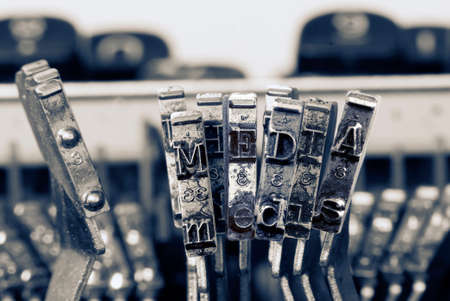 the word MEDIA with old typewriter hammers  in monochrome Imagens