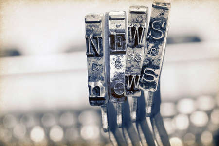the word NEWS with old typewrter hammers in monochrome