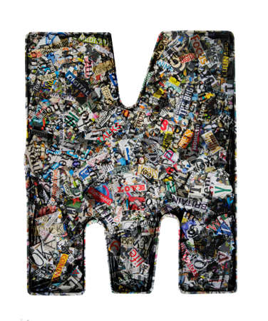 Capital letter  M made from cut up old newspaper  and magazine clippings Macro photography
