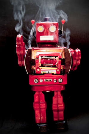 mad  red robot on fire with smoke and black background Imagens - 117349136