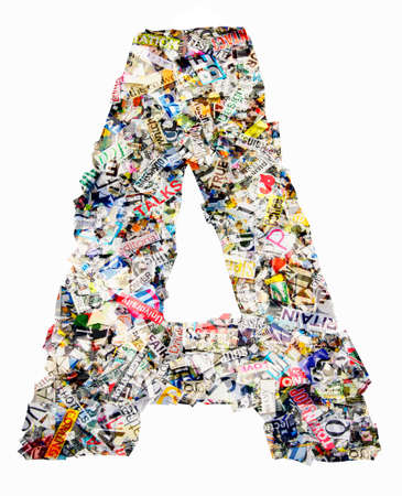 The letter A made from newspaper confetti Фото со стока