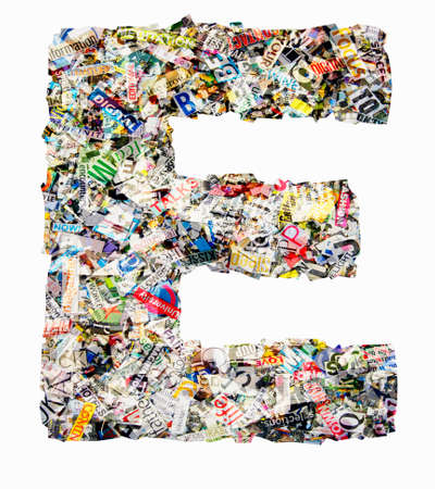 The letter E  made from newspaper confetti