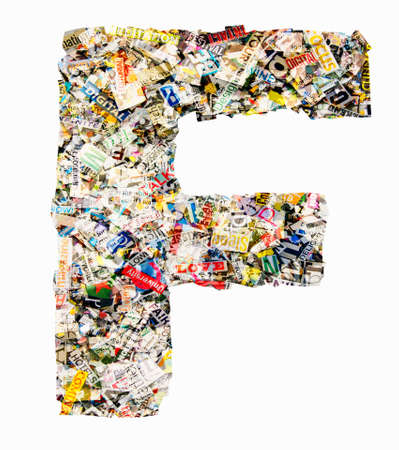 The letter F  made from newspaper confetti Imagens - 117349154