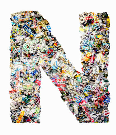 The letter N made from newspaper confetti Imagens