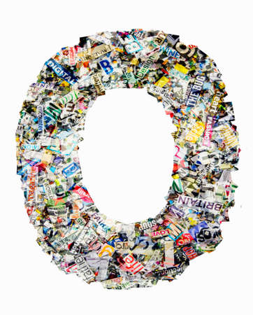 The letter O  made from newspaper confetti Imagens