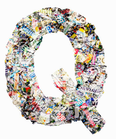 The letter  JQ   made from newspaper confetti