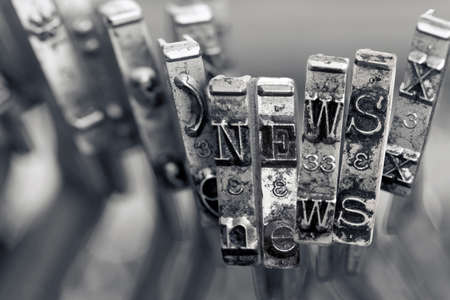 the word NEWS with old typwriter hammers macro image  monochrome image