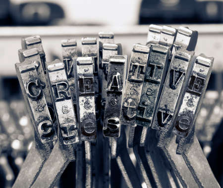 the word   CREATIVE  with old typwriter keys  monochrome