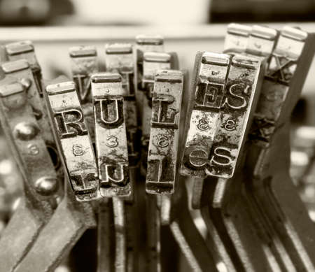 the word   RULES   with old typwriter keys  monochrome Фото со стока