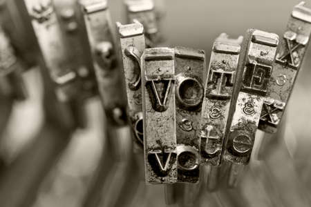 the word   VOTE with old typwriter keys  monochrome Фото со стока