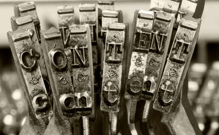 the word  CONTENT  with old typwriter keys  monochrome Imagens