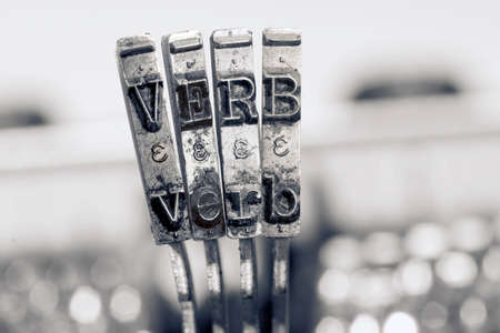 the word  VERB  with old typwriter keys  monochrome