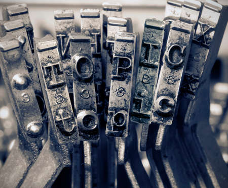the word   topic with old typwriter keys  monochrome Imagens