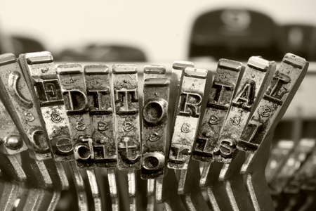 the word EDITORIAL  with old typwriter keys  monochrome isolated Фото со стока