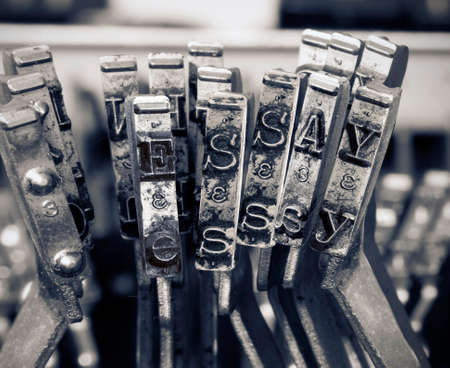 the word ESSAY  with old typwriter keys  monochrome Фото со стока